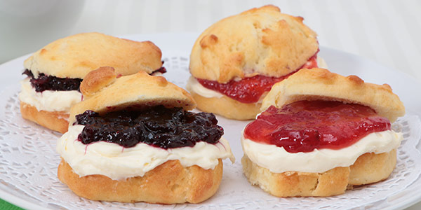 Tea biscuits with cream cheese and jam
